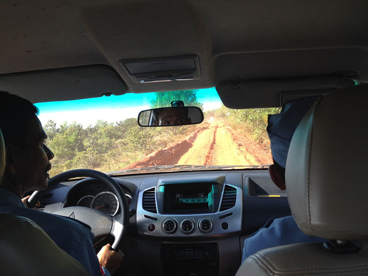 car driving on red earth track