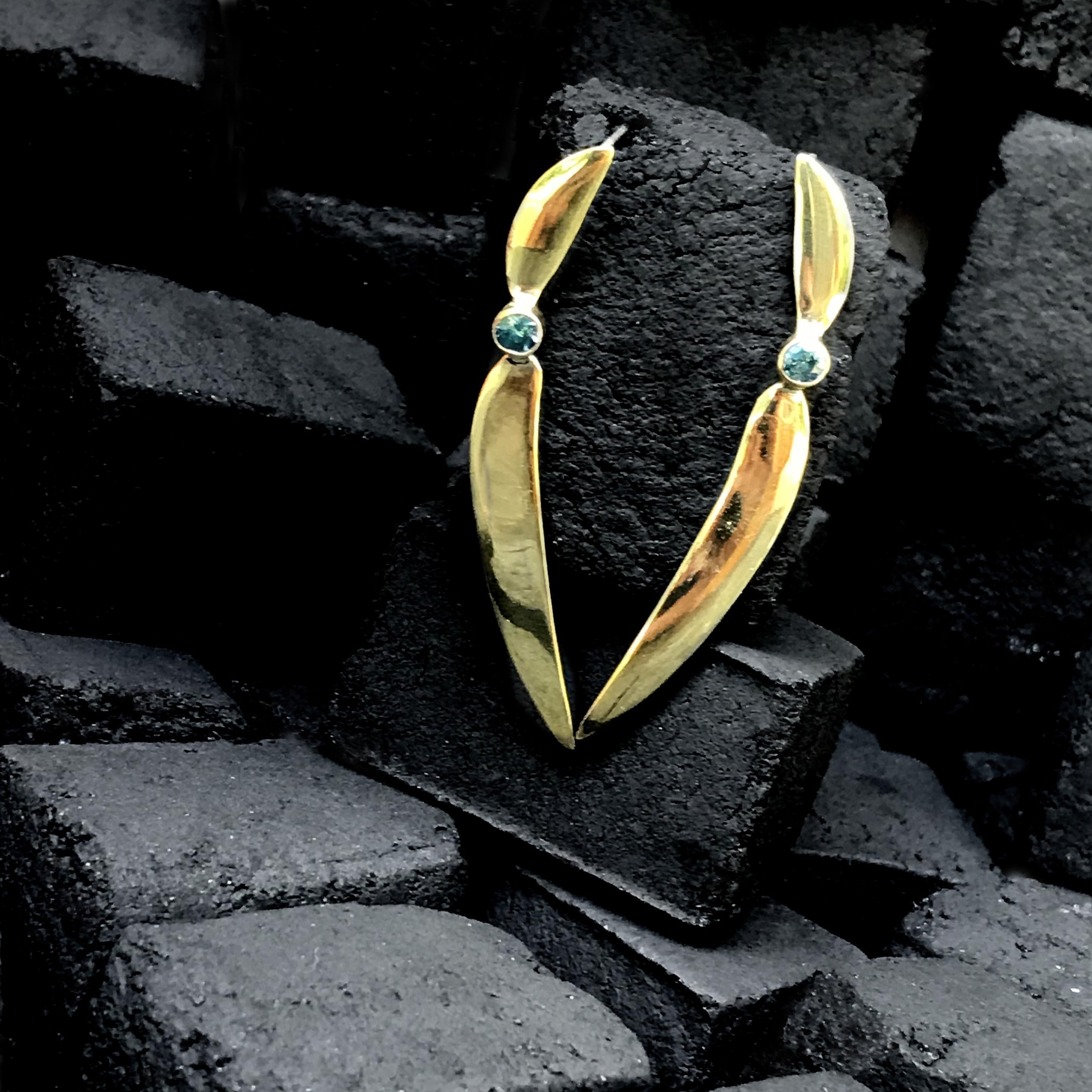 Earrings with zircon stones
